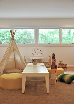 I love the calm Montessori-esque-ness (how is that for a word) of this playroom.  I am trying to create more of a peaceful environment down in the family room, rather than one where all the toys always come out.