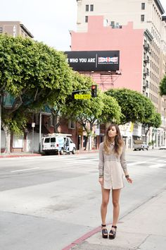 Rumi Neely of Fashion Toast wearing our Dove Silver Crop Top, Button Down Tunic and Jewelry
