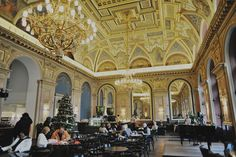 The Cafe above the Alexendra Bookstore on Andrassy Boulevard is enormous, lined with gorgeous stained glass windows and arched mirrors. The walls are decorated with gold and marble. The ceilings are vaulted and covered with beautiful frescoes (painted by the same artist who painted inside the Budapest Opera House and Saint Stephen's Basilica). On one side of the room stands a baby grand piano for afternoons with live music, on the other a confectionary display.