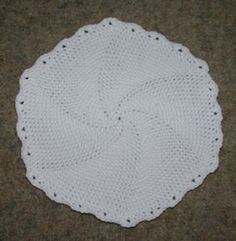 "In The Round Placemat Crochet Pattern - Looking at this ""with different eyes"", I can ""see"" a baby blanket in the rnd (increase hook size, add more rnds), or possibly a rug, (definate increase in hook plus cotton cord/clothesline)"