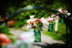 Barn at Fallingwater wedding. Hanging mason jar DIY arrangements. www.devotedtoyouevents.org