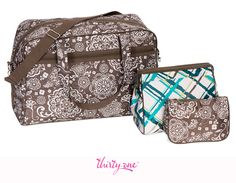 We love how the patterns mix and match together in this perfect travel set! This set features the City Weekender in Brown Woodblock Floral and Cosmetic Bag Set in Sea Plaid. Mythirtyone.com/206510