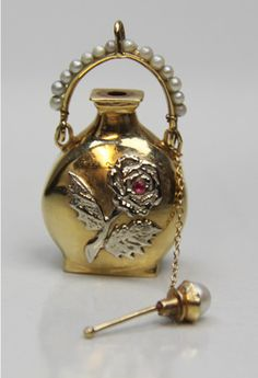 1918 antique perfume bottle 14k gold ruby and pearls. 14K yellow gold with a white gold rose on the front