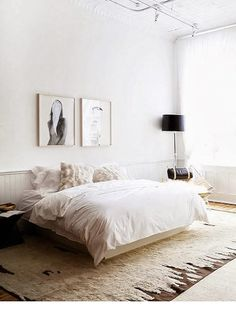 Cozy neutral toned bedroom with fuzzy rug and furry pillows
