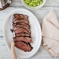 Grilled Leg of Lamb with Feta and Herb Salsa | In this spin on the classic pairing of lamb and mint, the butterflied leg of lamb is rubbed with a garlicky, spicy mint pesto, which is also used to flavor a feta-herb salsa. The salsa makes a fantastic sandwich spread for any leftovers.