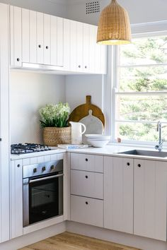 kitchen with white paneled doors - photo caroline mccredie