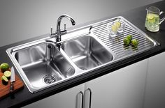 Kitchen Sink with drip tray.  Love rectangle sinks that are wide & deep. Its practical for washing dishes & even soaking. A round sink is a def no-no for me