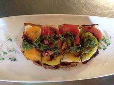 "#Heirloomtomato ""toast"" W/ mozzarella curd, arugula pesto, pine nuts"