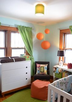 I'm beginning to like how orange fits into a blue and green room...  Maybe have a blue and green room - Orange details for a boy and purple details for a girl... hmmm