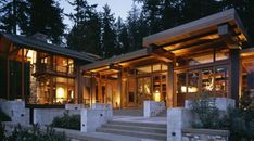 Miller Hull designed this secret dream home to become one with nature. The trees shadowing around the house are 75-100 foot tall Douglas Firs. Leaving uninterrupted westward views of the Puget sound and Olympic Mountains.    It's really nice to see that the lumber used in the house was actually salvaged from a shipwreck in 1921. It was planed into large 19″ x 19″ beams that formed the main living rooms. Each section of the house was specifically designed for the needs of the room. To top all...