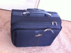 Camus carry on suitcase  - 35x40x25cm (heightxwidthxdepth). Telescopic handle.  $25