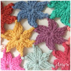 """Two days ago when I actualy was working on my """"triangle circle"""" project, I felt like crocheting flowers to cheer up the rainy grey day. I po..."""