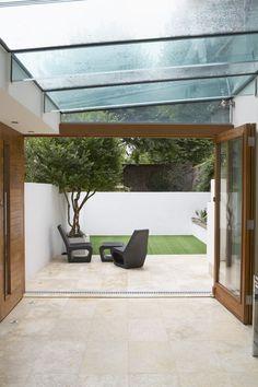Mmmmm, those doors! Indoor Outdoor Living, Outdoor Spaces, Outdoor Decor, Small Terrace, Terrace Garden, British Colonial Style, Underground Homes, Outdoor Flooring, Small Garden Design