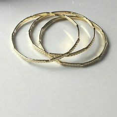 3 Gold Bracelets New with tags and price is firm unless bundled.Thanks and have a wonderful day everyone. Jewelry Bracelets