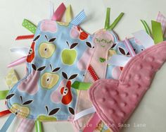 Butterfly Ribbon Tag Blankie in Alexander Henry Apples and Pears Print Pink, Red, Yellow, Green, Blue Minky Blanket Lovey Lovie Baby Gift. $24.00, via Etsy.