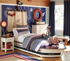 If I have a boy; I want this pirate/nautical room for him (I kind of want it for me)!  The boat bed and pirate mast ARRRRGH too cute!