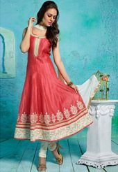 Art silk readymade anarkali kameez in dark peach. This attire is enhanced with zari, resham and patch border work. Available with a beige art silk churidar and a beige faux chiffon dupatta. The kameez length is customizable from 48 inches to 50 inches respectively. Attachable short sleeves are provided for your customization. Do Note: Slight variation in actual color vs. image is possible.
