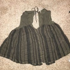 Free People Open Back Tank Worn once- no rips/pulls/etc. Color is dark olive/army green. Super cute with high waisted shorts and a bralette!! Free People Tops Tank Tops
