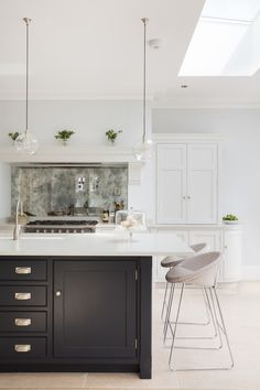 skylight ceiling window? chunky island like  flint splasback idea - like trhis marble colour could use surfaces?