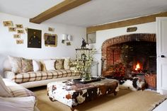 """[i]The sitting room features a distinctive cowskin ottoman from [link url=""""http://www.georgesmith.co.uk/""""]George Smith[/link].[/i]  Like this? Then you'll love  [link url=""""http://www.houseandgarden.co.uk/interiors/living-room""""]Living room ideas[/link]"""