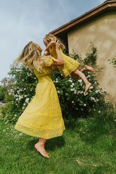 Take our Sunny Dress outside this Summer. The perfect yellow dress to brighten any closet. From eyelet detailing to a midi length, this is a dress you will all be dying to have. Mommy And Me Dresses, Little Girl Dresses, Picture Outfits, Dress Picture, Sunny Dress, Mommy And Me Photo Shoot, Summer Family Photos, Date Night Dresses, Holiday Party Dresses