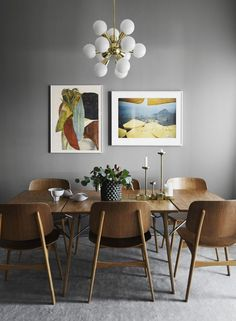 Stylish lighting for homes. Dining room idea with colorful framed pictures, large wood table and grey walls. Dining room idea with colorful framed pictures, large wood table and grey walls. Decoration Inspiration, Dining Room Inspiration, Decor Ideas, Decorating Ideas, Design Inspiration, Decorating Websites, Wall Ideas, Interior Inspiration, Interior Decorating