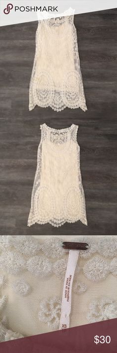 Free People White Lace Dress XS/S - WORN ONCE I wore this Free People cream lace dress for senior pictures and never wore I️t again. It's a beautiful fit. I️t comes with a cream slip and lace overlay dress. No issues - just not my style Free People Dresses Midi