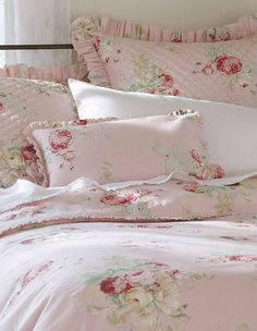 Immensely beautiful pink and pale mint green hued shabby chic bedding. Love! #bedding #pink #bedroom #blankets #shabby #chic #roses