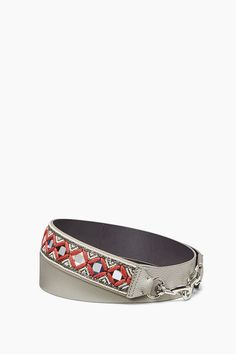 Mirror Guitar Strap - Customize any handbag with a uniquely designed guitar strap. The intricate design lends a rock 'n' roll edge to any bag for a personalized look.Style #: XU17EGSM45