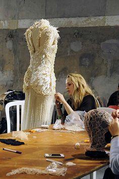 Haute Couture, the making of a dress - dressmakers hand embellishing an Alexander McQueen gown - fashion design behind the scenes; fashion atelier
