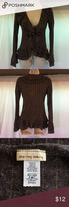 Ladies brown front-tie sweater sz small Ladies brown front tie sweater with gold metallic thread accents by The Rag Story.  Size small.  Ruffled collar, ruffled hem and ruffled bell sleeves. This piece looks good on ANY frame.  Very flattering cut and hang. Can be worn at the office, happy hour, after five or any occasion.  Dress it up or dress it down.  Such a versatile piece. Not normally your style?  Try it anyway.  You'll love it!  Acrylic, nylon, metallic blend. Sweaters V-Necks