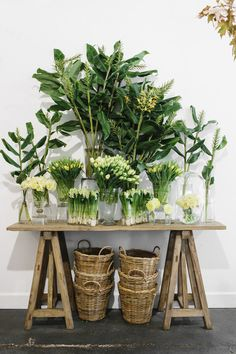 baskets and greenery, wood table...love it