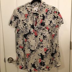 NWOT Loft floral blouse Super cute ivory/navy/pink floral blouse. Has a flat accordian collar and an optional bow. In perfect condition! 70% cotton, 30% silk! LOFT Tops Blouses