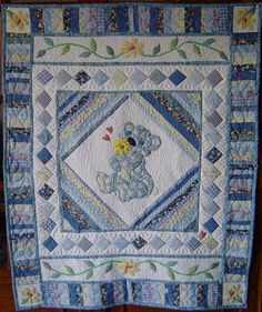 Patchwork and applique design in blue for a little boy (Original Design). Too much work unless for your own grandchild! Extremely artistic, designer!!