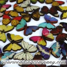 These delightful, painted wooden butterflies make cute favor and inviations accents. Great for table confetti and scrapbooking too! Butterflies measure 1-inch across. Wedding decorations & Event Supplies - www.yourweddingcompany.com