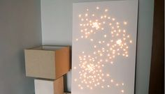 So easy! Just push christmas lights through a white canvas. (Or paint the canvas something fun... like gold)