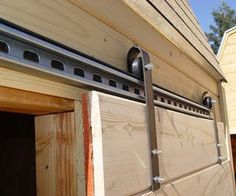 DIY barn door hardware from skateboard wheels Diy Sliding Barn Door, Double Barn Doors, Sliding Barn Door Hardware, Diy Door, Sliding Doors, Door Latches, Door Hinges, Sliding Door Wheels, Door Brackets