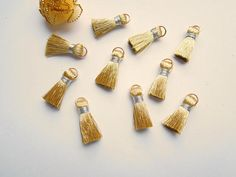 Hey, I found this really awesome Etsy listing at https://www.etsy.com/uk/listing/535459990/10-gold-mini-jewellery-tassels-silver