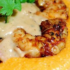 Georgia Shrimp 'n' Grits: spicy sauteed shrimp rest on a bed of sharp cheddar grits, topped with a creamy roux and slivers of country ham
