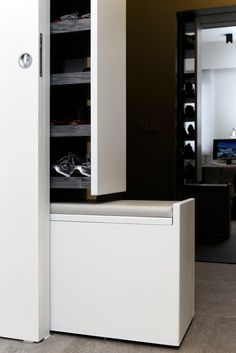 No space for shoes at your entrance hall as traditional shoe cabinet takes up too much space? A concealed sliding shoe cabinet can be a good alternative with a sliding stool at bottom which makes your life much easier when running for work in the morning!