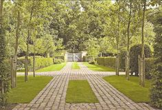 The perfect gate/cobblestone driveway.  Simple earthy landscape architecture
