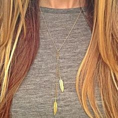 NWT Sparkling Gold Feather Necklace Brand new with tags cute sparkling feather necklace. Length of the chain is about 50 cm. Feel free to ask me any questions. Great discount on bundles! Thank you and namaste  Jewelry Necklaces