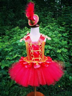 This very cute red circus tutu dress is perfect for themed birthday party and any time your little one wants to dress. I am using 2 layers of tulle for the skirt. Ribbon ruffles decorate the waist.  The mini top hat is attached to an elastic band. It is NOT included in this set. Please see the following link:  https://www.etsy.com/ca/listing/291036417/carnivalvenice-carnivalpurple-green  If you like the whole set, please let me know. I will make a link for you so...