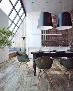 dining space - exposed brick walls, dark timber table with turned legs paired with Eames chairs
