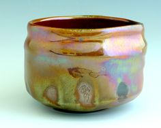 Oni Shino wood-fired tea bowl. The Opalescent luster on the bowl is the result of a reduction cooling. By Marc Lancet