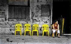 waiting outside a dentist's in Hanoi