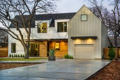 In addition to the home's exterior, the garage is clad in a fiber cement siding that is not only rot-proof but provides climate control for keeping cool air in and hot humid air out. Mountain Home Exterior, Modern Mountain Home, Fiber Cement Siding, Metal Siding, Garage Exterior, Car Garage, Garage Doors, Garage Pictures, Smart Home Design