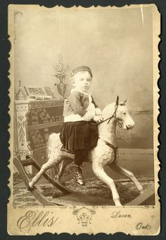 Vintage photo, little boy on a rocking horse