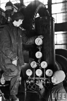 Margaret Bourke-White - Two Russian female workers tending gauges and controls while on duty at an electric power house, Magnitogorskrosk, Russia, 1931.