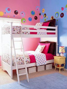 Pink/purple walls with white bunk beds; under bed storage (via Parents.com)